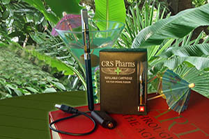 CRS Pharms box, e-pen, art book, martini stemware and umbrella  on table