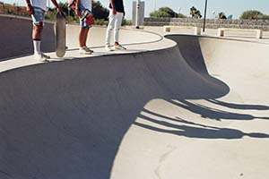 edge of skateboard ramp with waiting skaters